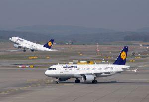 Aircraft waiting on a runway at the airport