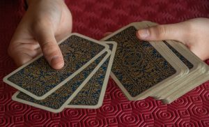 Playing cards being dealt