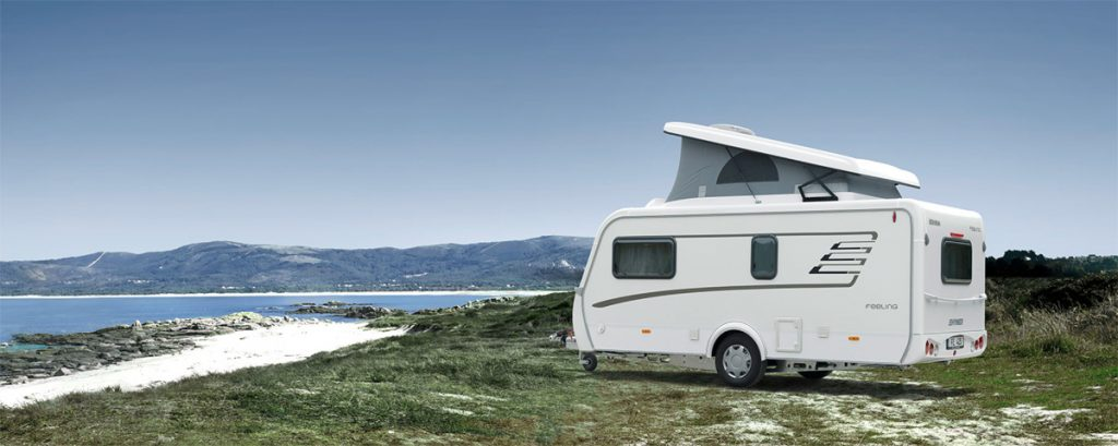 Travelworld caravan parked next to the beach